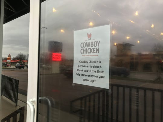 The closed sign on the front door of Cowboy Chicken Wood Fire Rotisserie at 2700 W. 41st St. in Sioux Falls, April 22, 2019.