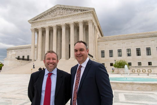 4/22/19 10:51:25 AM -- Washington, DC, U.S.A  -- Jonathan Ellis, reporter, left, and Cory Myers, news director, of the Argus Leader newspaper based in Sioux Falls, S.D., stand in front of the U.S. Supreme Court after their news outlet argued in a case that could determine whether taxpayer payments to businesses can be considered confidential information on April 22, 2019.  --    Photo by Hannah Gaber, USA TODAY staff ORG XMIT:  HG 137950 SCOTUS Argue Lea 4/22/2019 (Via OlyDrop)