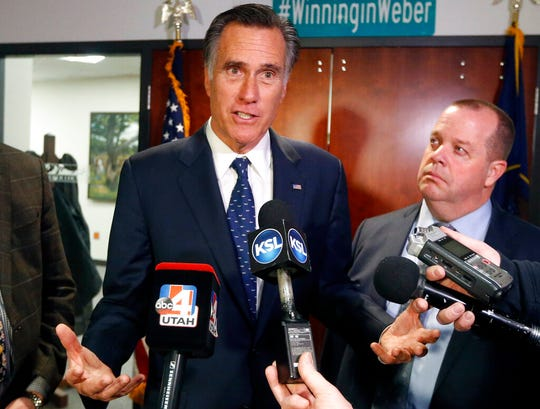"FILE - In this Friday Jan., 18, 2019 file photo, Utah Sen. Mitt Romney, left, speaks with reporters after visiting with local officials to discuss how the four-week partial government shutdown is impacting an area with several major federal employers, including the Internal Revenue Service in Ogden, Utah. Sen. Mitt Romney says he's ""sickened"" by the dishonesty the Russia investigation found in the Trump White House. Now President Donald Trump is firing back at the Utah Republican, tweeting Saturday, April 20, 2019 that if Romney ""spent the same energy fighting Barack Obama as he does fighting Donald Trump, he could have won the race (maybe)!"" Romney has been one of the few prominent Republicans to criticize Trump since Trump's election. (AP Photo/Rick Bowmer, File)"