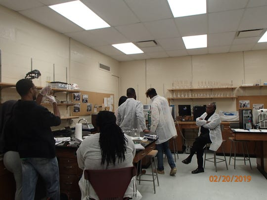 Charles Magee, professor of biological systems engineering, far right, with students in lab at Florida A&M University.