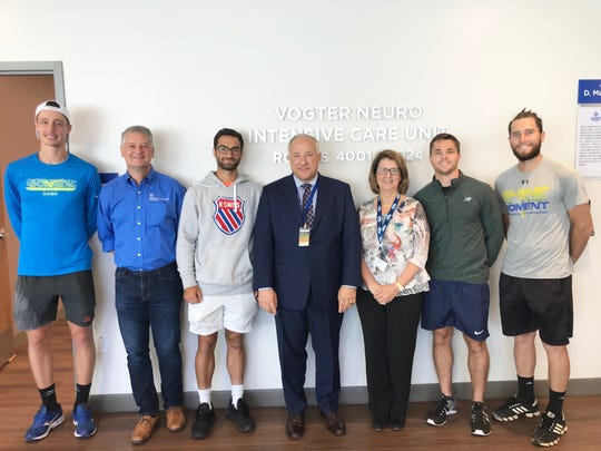 From left to right: Marc Polmans, Dr. Christopher Rumana, Noah Rubin, Nigel Allen, Karen Vogter, Anderson Reed and Hunter Reese got a chance to see the Vogter Neuro Intensive Care Unit prior to the start of the Tallahassee Tennis Challenger on Monday, April 22, 2019.