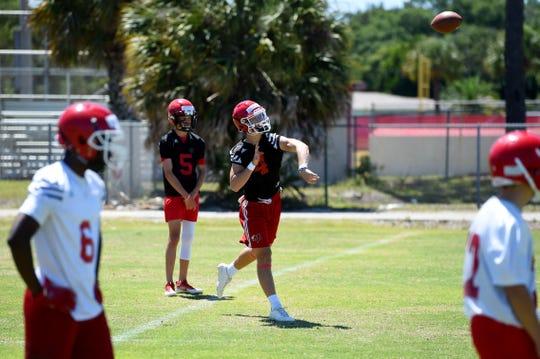 Vero Beach rising senior quarterback Ryan Jankowski throws a pass during spring practice on April 22, 2019.