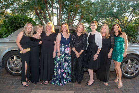 The Glitter Glam Squad, from left, Katie Makemson, Kathy Carmody, Colleen Holmes, Kira Libratore, Marsha Cetta, Peggy Wood, Tammy Calabria and Kristin Crall.