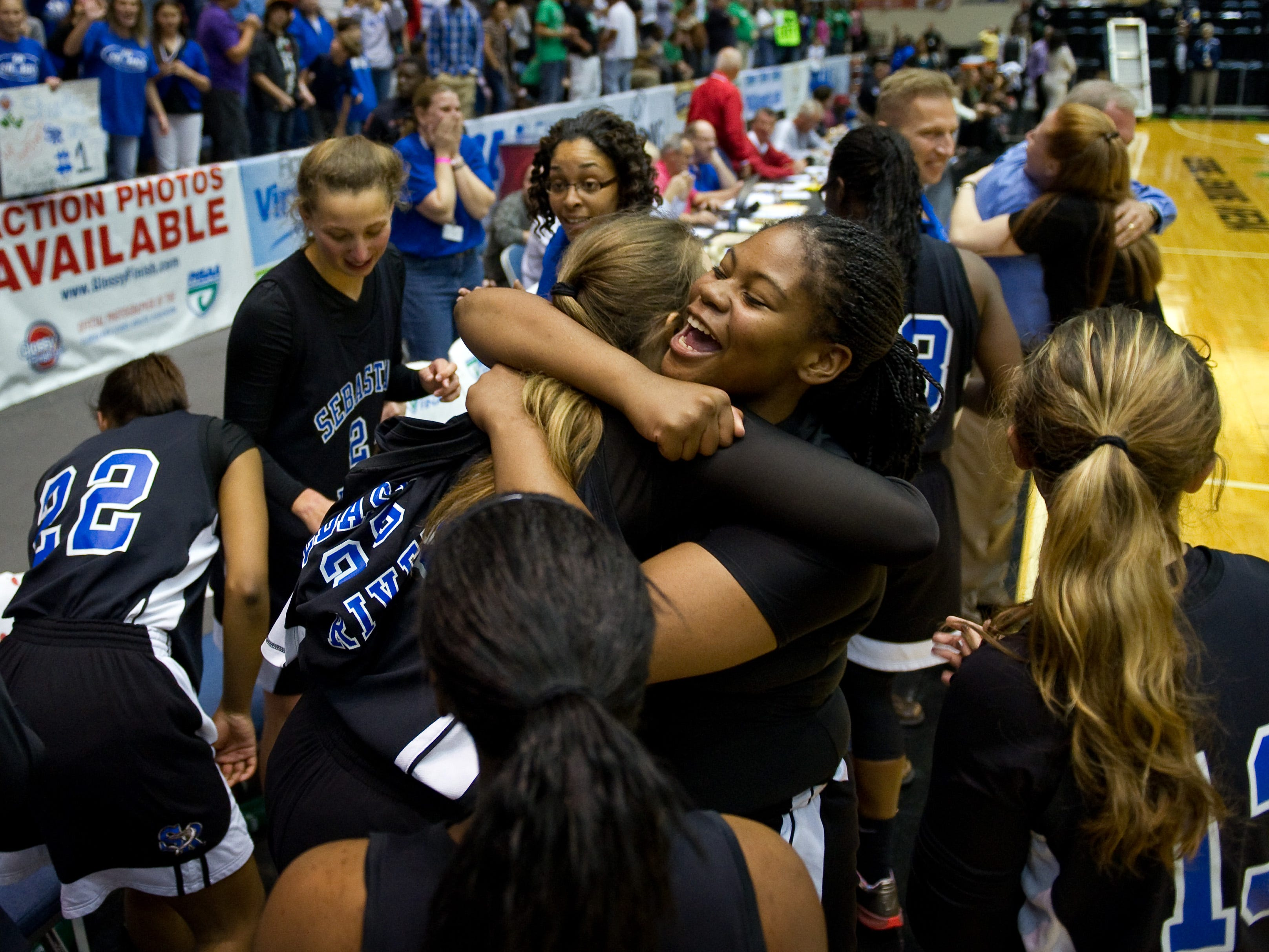 Tayler Smith (right center), celebrates Saturday, Feb. 25, 2012, with her teammates following Sebastian River High School's 50-46 win over Haines City High School during the 2012 FHSAA Class 7A Girls Basketball Championship in Lakeland.