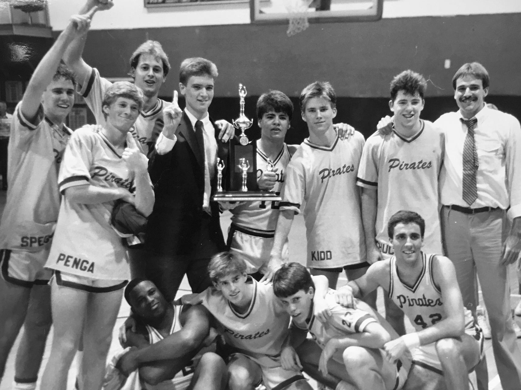 The St. Edward's boys basketball team coached by Ed Kohtala (right) celebrates their 1987 district title win over King's Academy from West Palm Beach. King's Academy was the 10-year reigning district champions until that year. Kohtala began his coaching career in the 1984-85 season as the head basketball coach and teacher at St. Edward's Upper School in Vero Beach, and stayed there for four seasons.