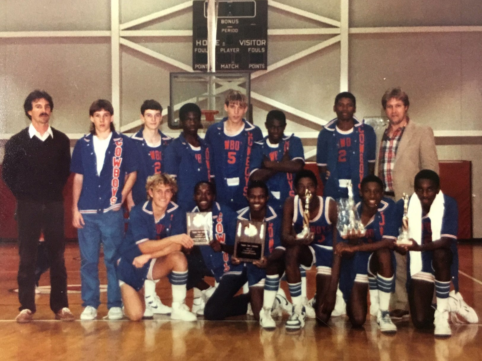 The Sebastian River Middle Junior High School basketball team pose for a picture in a year when they were Treasure Coast Conference tournament champions. Front, row from left: David Spalding, William Dawkins, Sivinti Ross, Roosevelt Jones, Demond Hinton, Octavius Jones. Back row from left: Coach Scott Adams, Sean Dunn, Jim Hulse, Robert Monroe, Wayne Everhart, Tyree Ross, Robert Pressley, Asst. Coach David Lunsford. The Sebastian River Junior High School team defeated Martin County and Vero Beach that year for the championship.