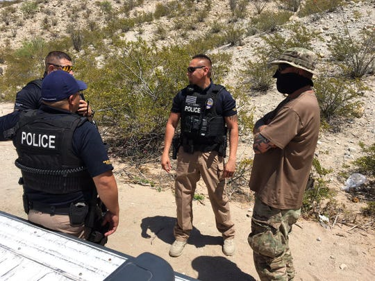 Sunland Park, New Mexico, police officers talked with a member of a group that monitors immigrants entering the country. The newly named Guardian Patriots are still in the Sunland Park area and patrolling the border.