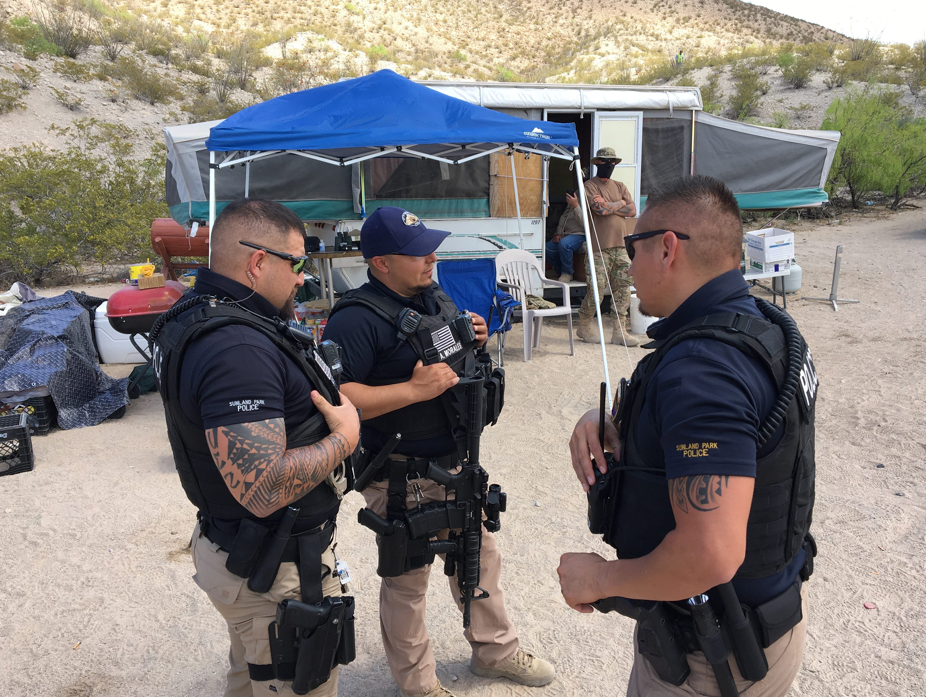 The United Constitutional Patriots-New Mexico Border Ops group were visited by law enforcement Monday as they erected 'No Trespassing' signs denoting the city of Sunland Park's boundary near their camp. Union Pacific Police said they are camped on railroad land and will need to vacate by Friday.