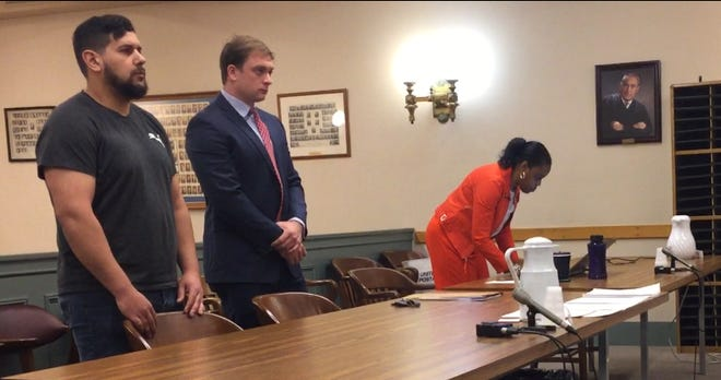 Vineland resident Jonathan Cruz, 28, (left) stands with defense counsel Anthony Imbesi at his arraignment Monday in Cumberland County Superior Court. At right: Assistant Prosecutor Kim Barfield.
