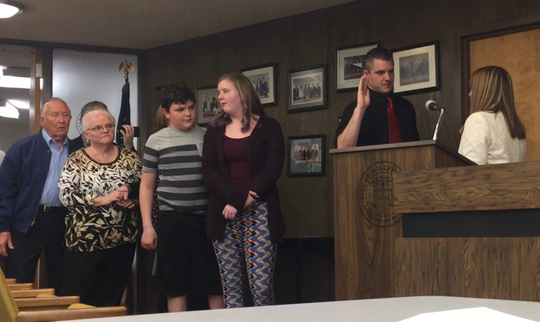 Brian Prohowich takes his oath of office from City Clerk Jeanne Hitchner after being appointed municipal engineer for the city of Millville at the April 16 City Commission meeting. Behind Prohowich are members of his family.