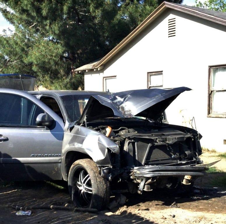 Armed man crashes into backyard before fleeing into Visalia neighborhood