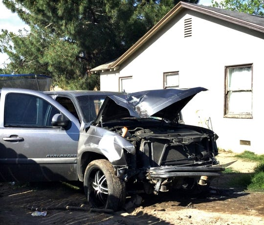 A truck crashed into a power pole and through a Visalia fence on Sunday, April 21, 2019.