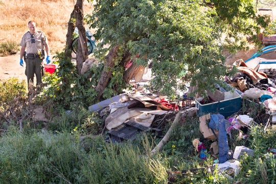 Tulare County Sheriff Department evicted homeless people from about 40 encampments along the St. Johns River west of Ben Maddox on Monday, April 22, 2019. Notice was given 30 days ago and social service workers were canvasing the homeless to offer services.