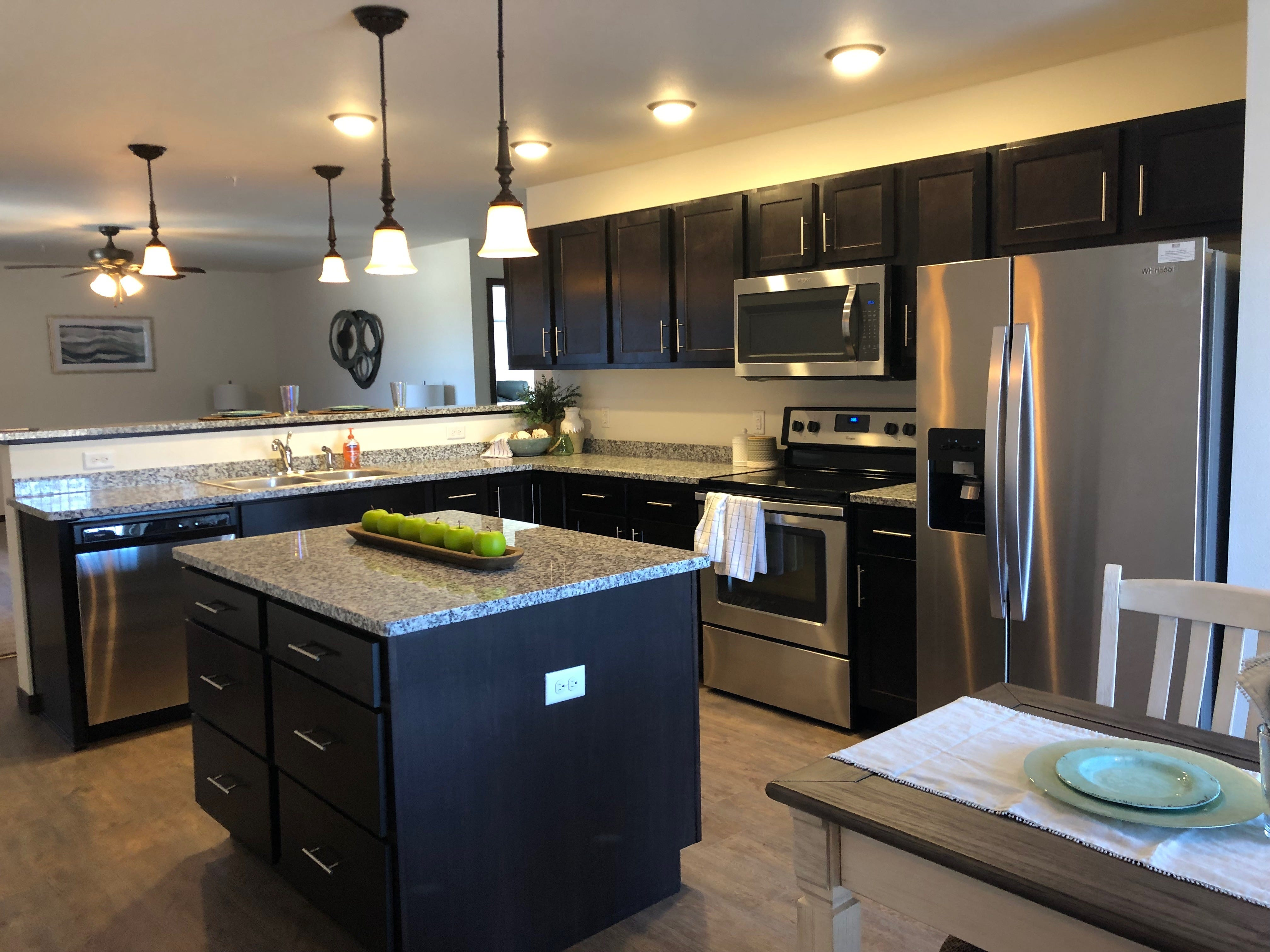 The kitchen in an apartment at the Westwood Estates. Because the rentals are higher-end, they all have granite counter tops and stainless steel appliances.