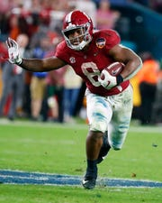 FILE - This Dec. 30, 2018, file photo shows Alabama running back Josh Jacobs (8) during the second half of the Orange Bowl NCAA college football game against Georgia, in Miami Gardens, Fla. Jacobs is a possible pick in the 2019 NFL Draft.(AP Photo/Wilfredo Lee, File)