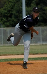 Kristin Mills-Caldwell pitching for the  East Coast Yankees in 2005 in the East Coast Women's Baseball League.