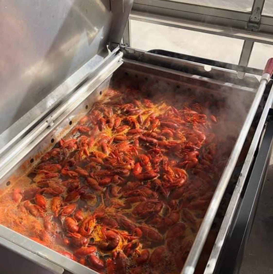 Crawfish chefs enjoy cooking for thousands of their closest friends
