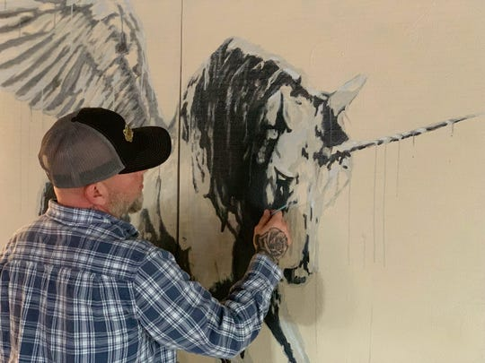 """Sorrow working on pieces for his new show """"Sorrow: Design for Living"""" that opens from 6 to 9 p.m. Saturday at 9th Street Studio. The artist will also introduce a new website making his previous art available in everything from art prints to shower curtains."""