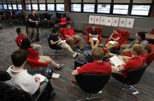 Rosecrans High School history teacher Mark Baker listens as his students in The Beatles: A Musical and Cultural Journey into Their Lives, Music and Times class discuss songs from the Beatles' Sgt. Peppers Lonely Hearts Club Band.