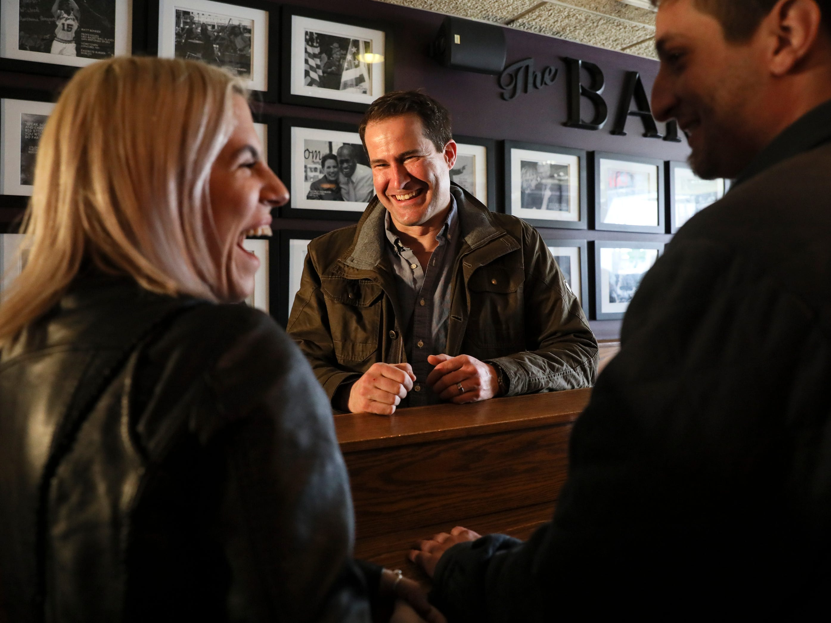 Rep. Seth Moulton, D-MA.., meets with patrons after participating in the Pints and Politics event held at The Barley House in Concord, N.H. Saturday, March 16, 2019. Rep. Moulton announced he is joining the presidential race on April 22, 2019.