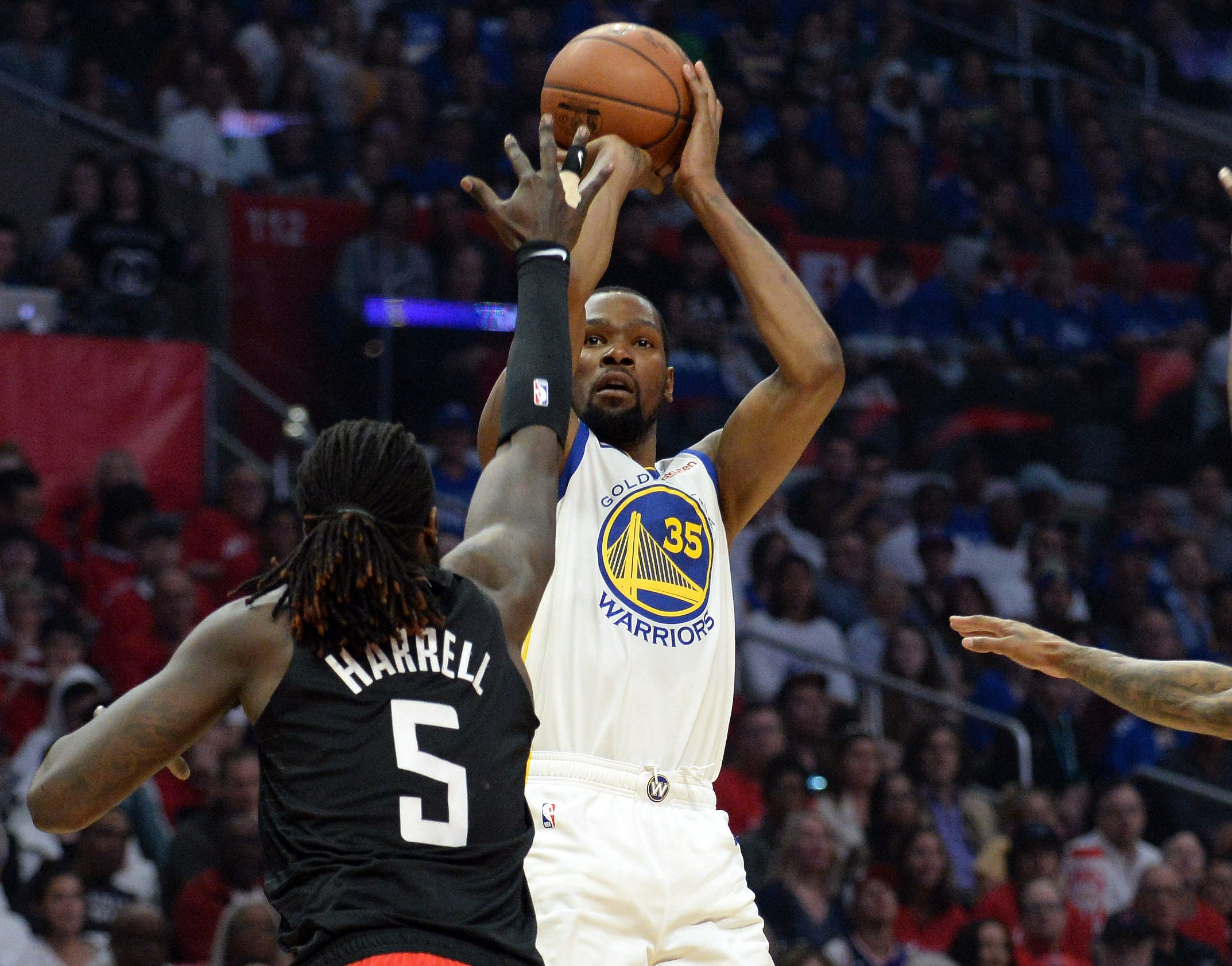 April 21: Warriors forward Kevin Durant (35) rises and shoots over Clippers defender Montrezl Harrell (5) during Game 4 in Los Angeles.