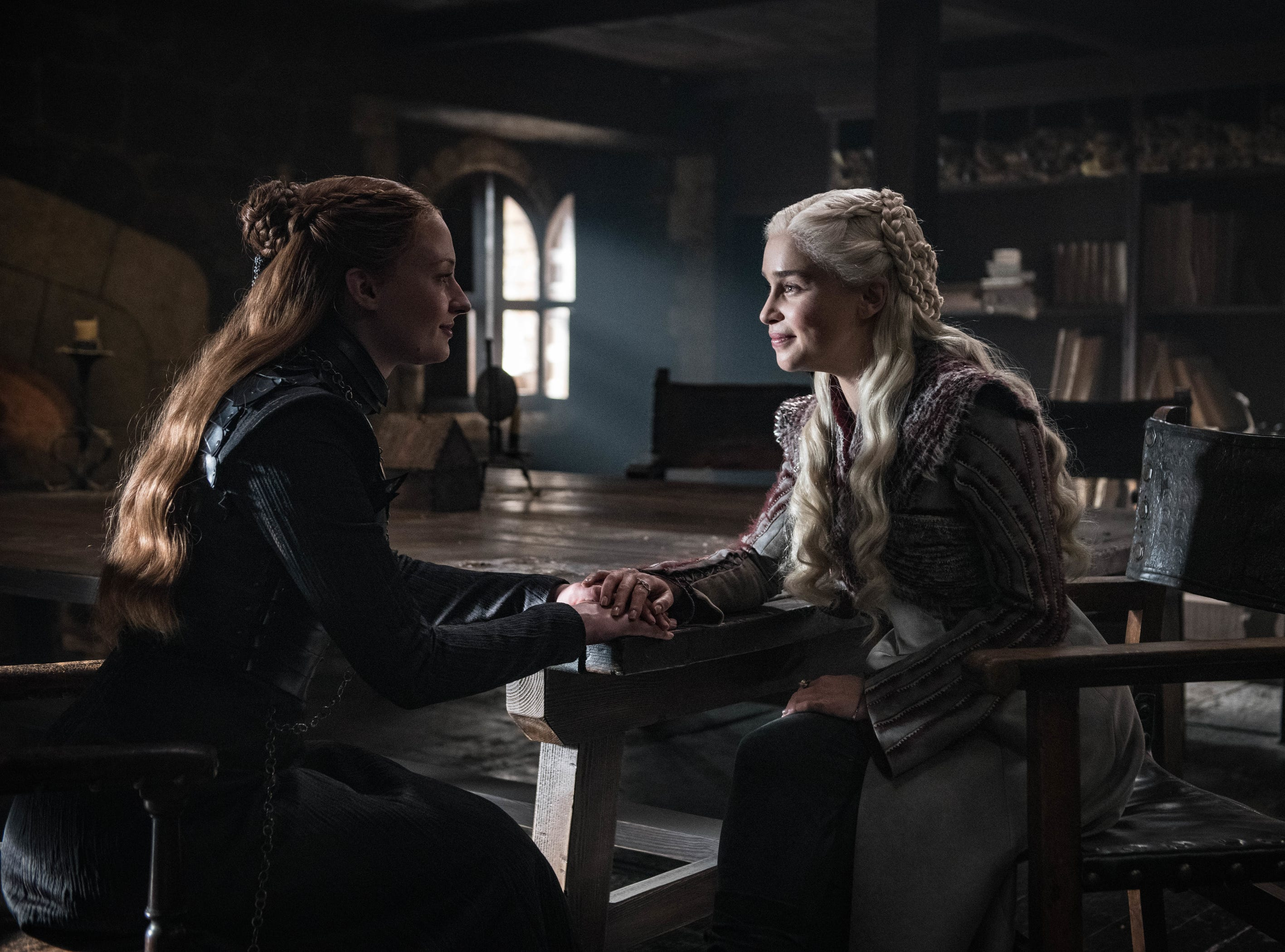 Sophie Turner as Sansa Stark, left, and Emilia Clarke as Daenerys Targaryen on HBO's 'Game of Thrones.'