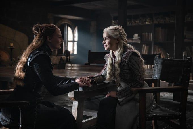 Sophie Turner as Sansa Stark, left, and Emilia Clarke as Daenerys Targaryen on HBO's 'Game of Thrones.'