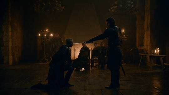 Jaime Lannister (Nikolaj Coster-Waldau), right, conveys a long-delayed and much-deserved knighthood to Brienne of Tarth (Gwendoline Christie) in the April 21 episode of HBO's 'Game of Thrones.'