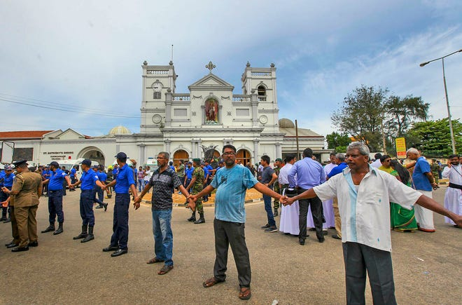 In this Sunday, April 21, 2019, photo, Sri Lankan army soldiers secure the area around St. Anthony's Shrine after a blast in Colombo, Sri Lanka.