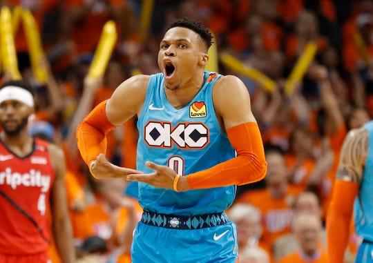 Thunder guard Russell Westbrook mimics rocking a baby after scoring against the Trail Blazers.