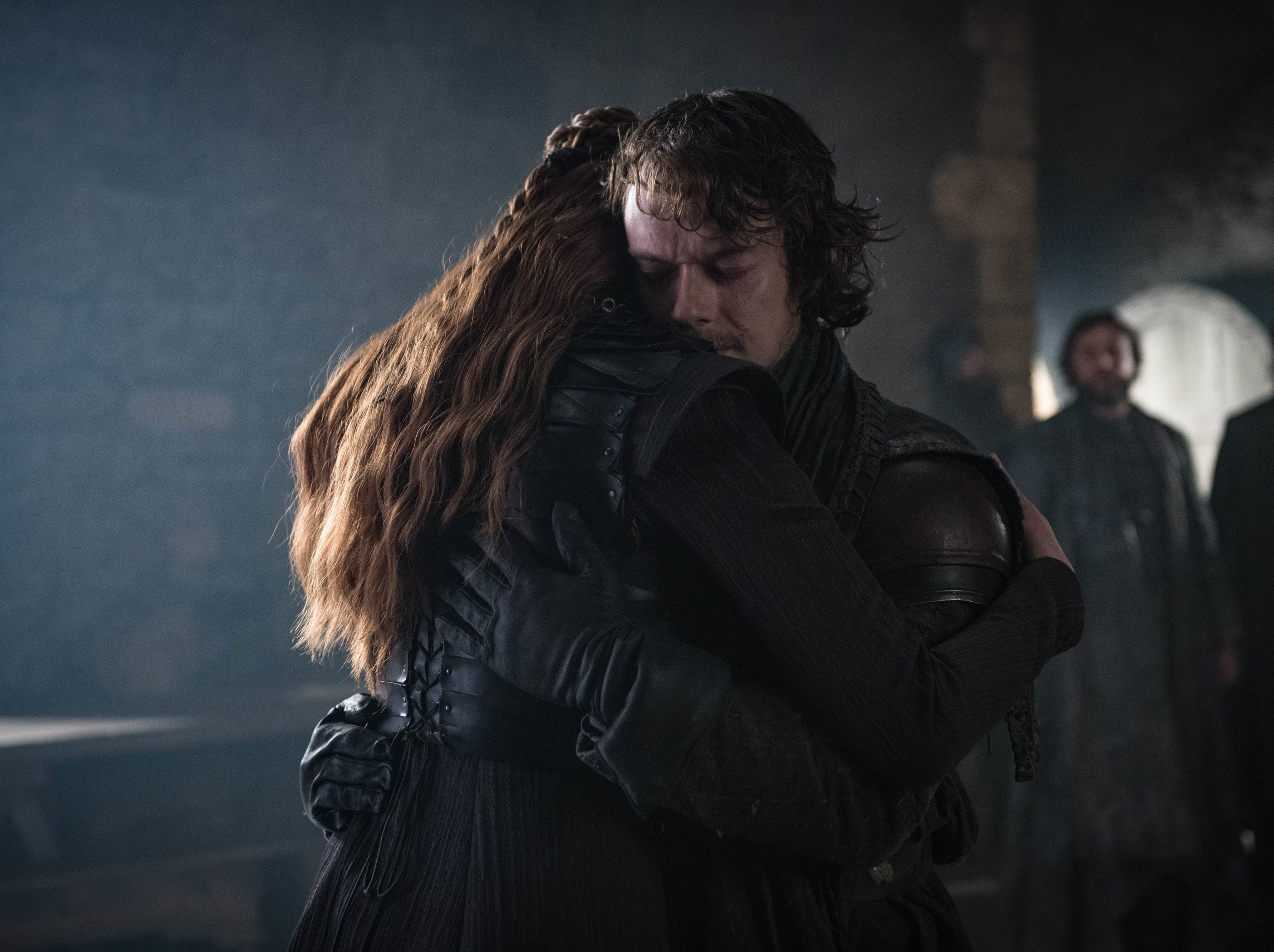 Alfie Allen as Theon Greyjoy, right, and Sophie Turner as Sansa Stark on 'Game of Thrones.'