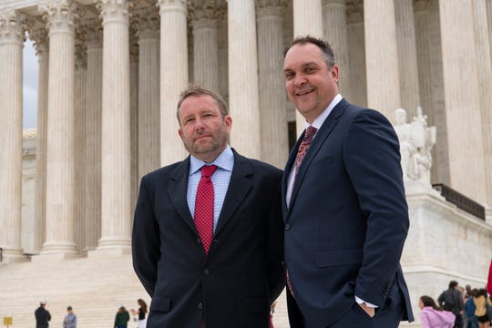 Jonathan Ellis and Cory Myers of the Argus Leader newspaper based in Sioux Falls, S.D., stand in front of the U.S. Supreme Court after their news outlet argued in a case that could determine whether taxpayer payments to businesses can be considered confidential information.