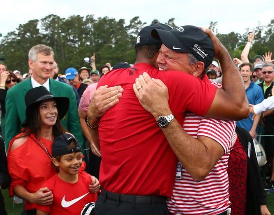 Tiger Woods hugs Glenn Greenspan after winning the Masters.