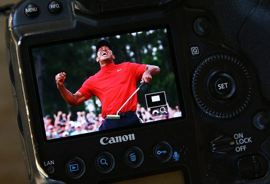 USA TODAY Sports photographer Rob Schumacher captures Tiger Woods' reaction on winning the Masters on his Canon camera.