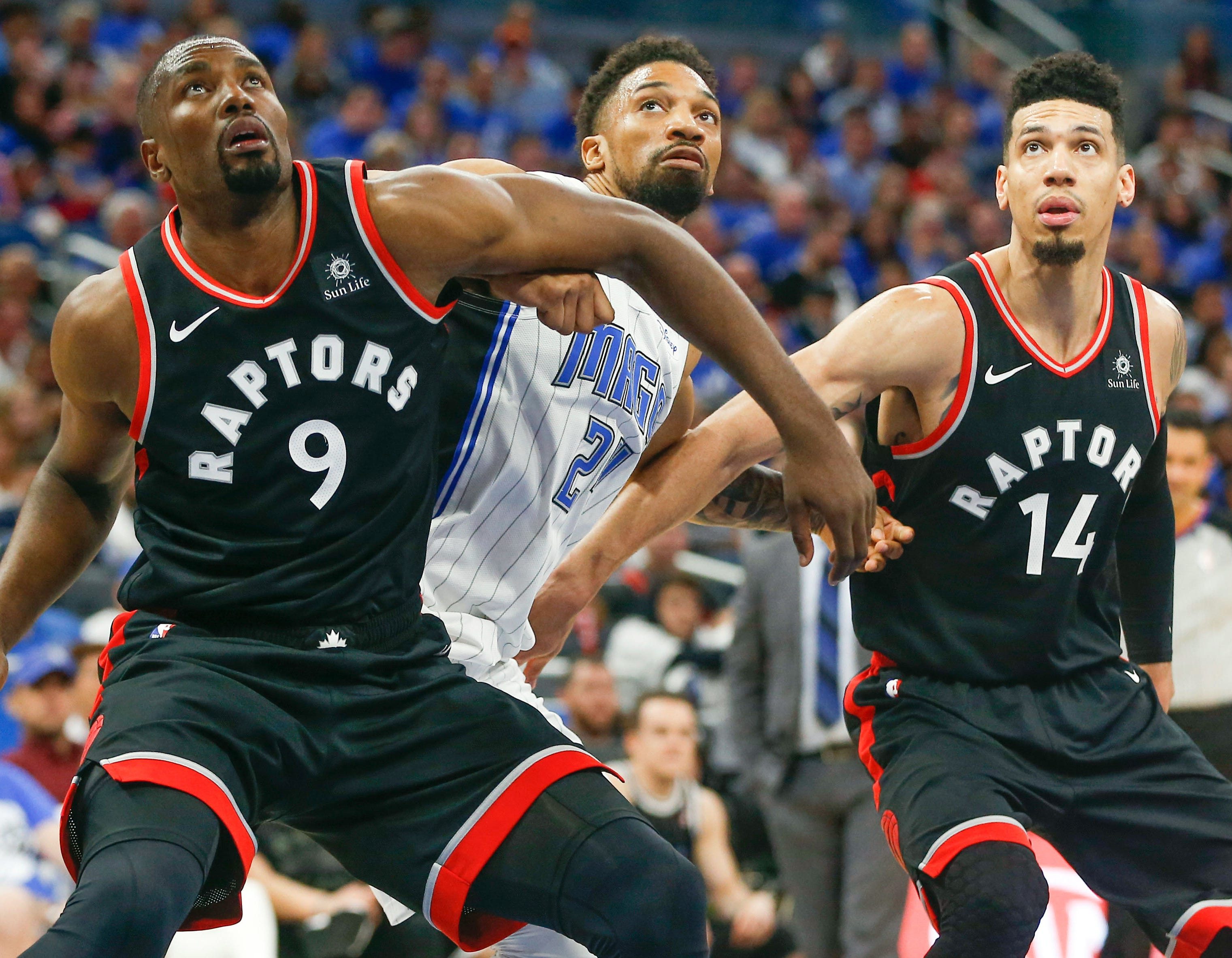April 21: Magic center Khem Birch (24) fights for rebound position between Raptors center Serge Ibaka (9) and guard Danny Green (14) during Game 4.