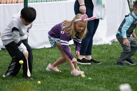 Kids take part in the annual White House Easter Egg Roll on the South Lawn of the White House on April 22, 2019.