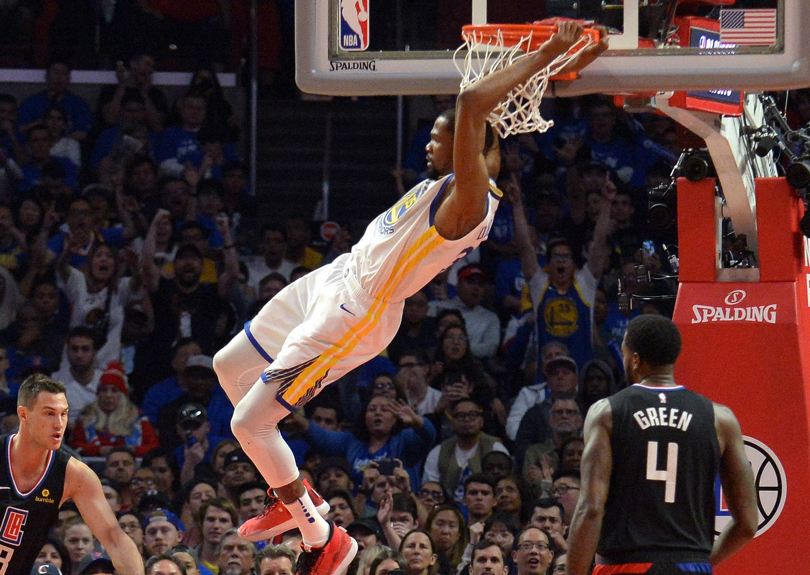 April 21: Warriors forward Kevin Durant throws down the two-handed slam during Game 4 against the Clippers.