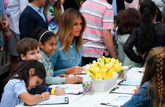 First lady Melania Trump draws with children during the annual White House Easter Egg Roll on the South Lawn of the White House on April 22, 2019.