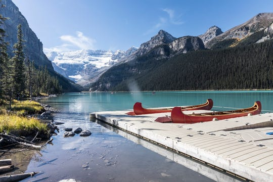 """Canoeing on Lake Louise is a favorite way to explore Alberta's most famous lake. Its milky turquoise color is a result of """"rock flour"""" from the melting glaciers above it."""