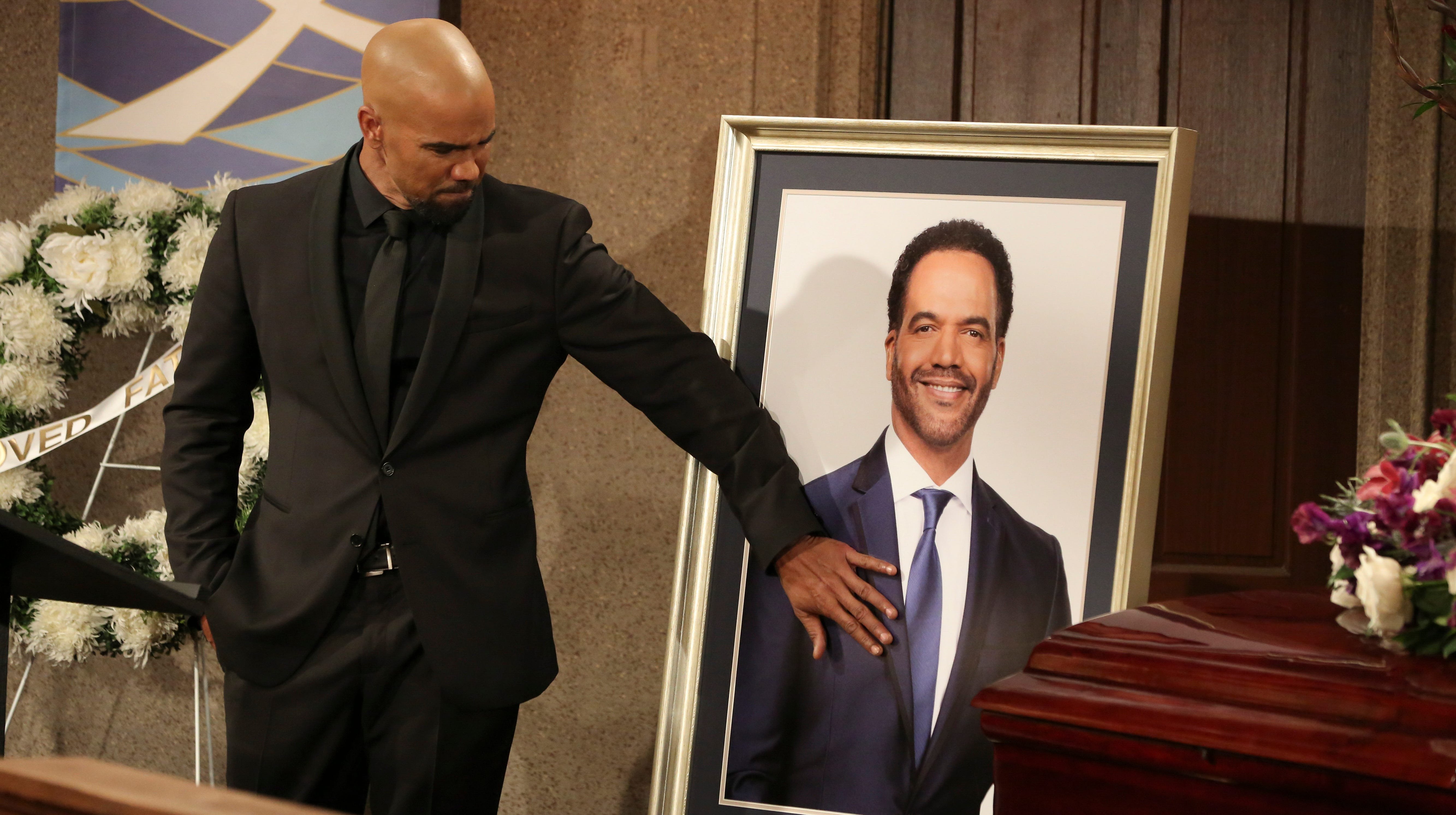 "This image released by CBS shows Shemar Moore portraying Malcolm Winters during a funeral scene for the character Neil Winters, portrayed by the late actor Kristoff St. John, in the daytime series ""The Young and the Restless."" St. John, who died at age 52 in February of heart disease, helped cement the prominence of major African-American characters in the traditionally white soap opera world. (Michael Yarish/CBS via AP) ORG XMIT: NYET112"