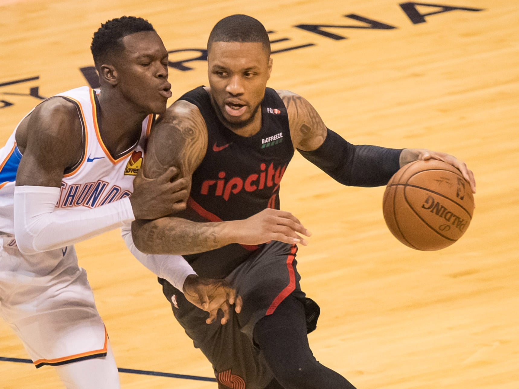 April 21: Trail Blazers guard Damian Lillard (0) looks for a driving lane against Thunder defender Dennis Schroder (17) during Game 4.