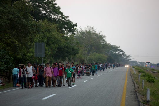 Central American migrants traveling in a caravan to the U.S. border walk on a road in Pijijiapan, Mexico, Monday, April 22, 2019. The outpouring of aid that once greeted Central American migrants as they trekked in caravans through southern Mexico has been drying up, so this group is hungrier, advancing slowly or not at all, and hounded by unhelpful local officials.
