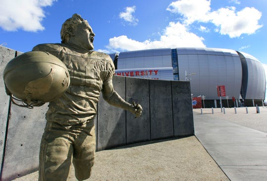 A statue of Arizona Cardinals football player Pat Tillman stands outside of what is now known as State Farm Stadium.