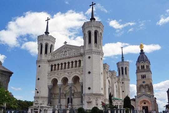 Perched atop Lyon's Fourvière Hill, Notre-Dame Basilica has an interior covered with beautifully elaborate mosaics.