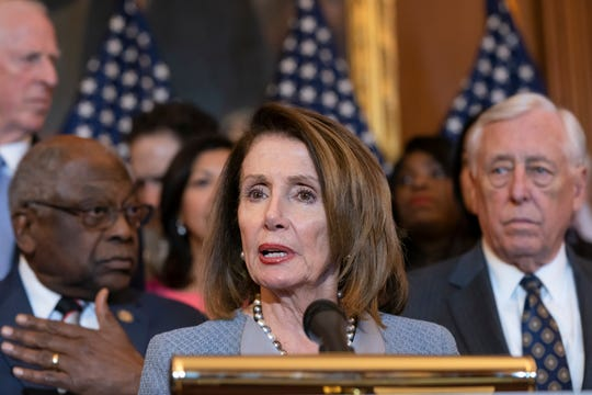 Speaker of the House Nancy Pelosi, D-Calif., flanked by Majority Whip James E. Clyburn, D-S.C., left, and House Majority Leader Steny Hoyer, D-Md.speak at the Capitol March 26, 2019.