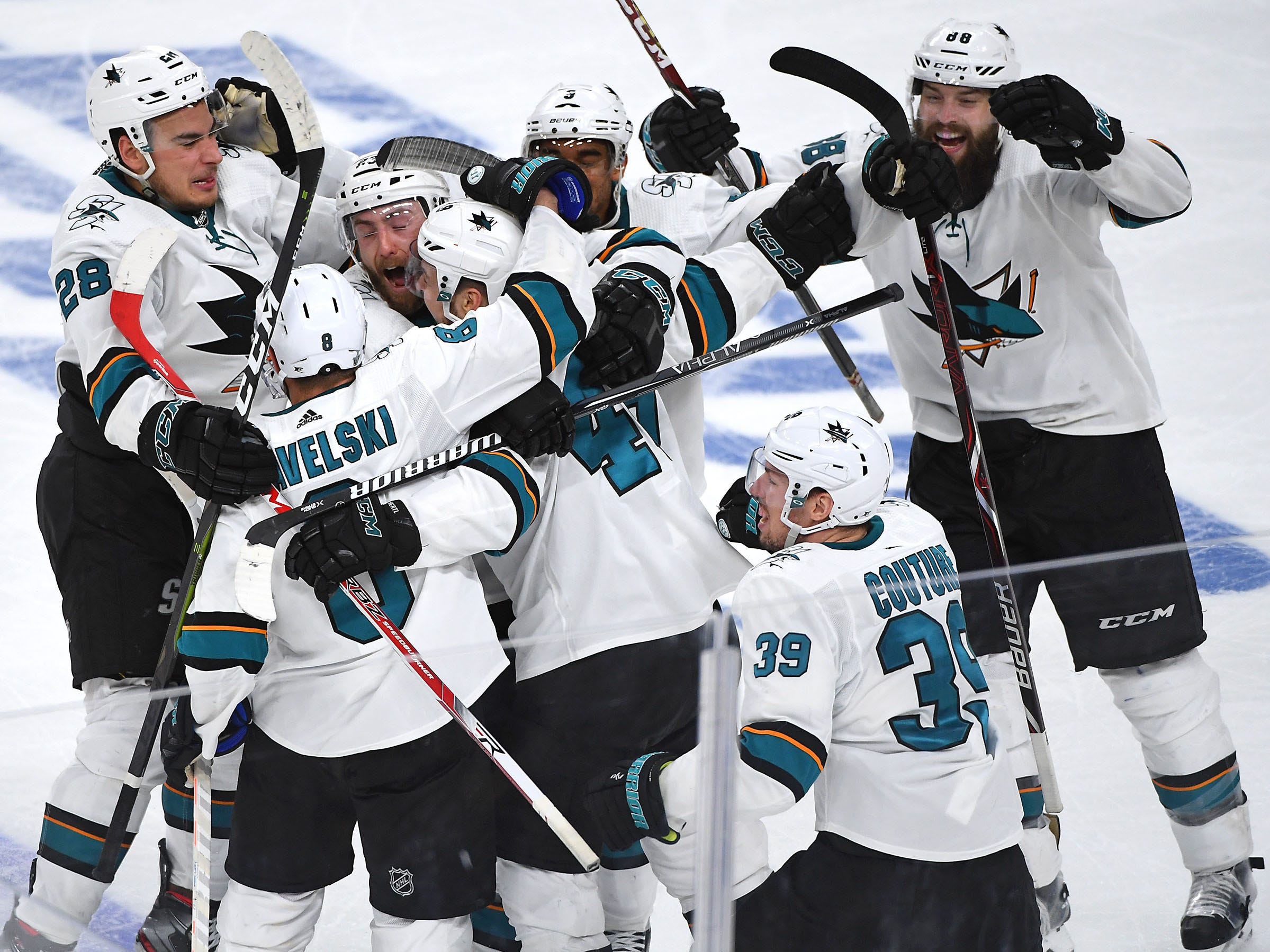 First round: The San Jose Sharks celebrate after forward Tomas Hertl scored in double overtime of Game 6 against the Vegas Golden Knights.