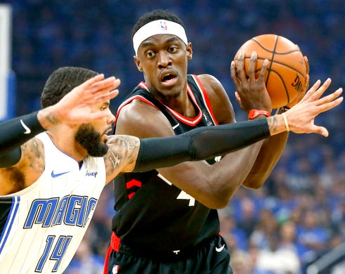 April 21: Raptors forward Pascal Siakam (43) tries to keep the ball away from Magic defender D.J. Augustin (14) during Game 4 in Orlando.