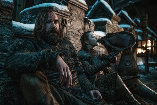 Rory McCann as Sandor 'The Hound' Clegane and Maisie Williams as Arya Stark on 'Game of Thrones.'