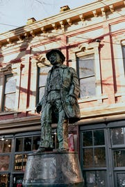 """This statue is named for John Deighton, a.k.a. """"Gassy Jack,"""" the neighborhood's original tavern's owner, and stands in Maple Tree Square."""