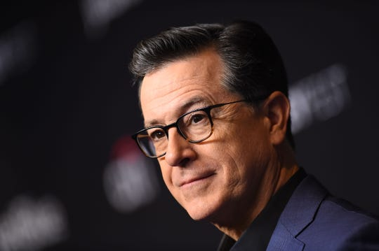 "US comedian Stephen Colbert arrives at the PaleyFest presentation of ""An evening with Stephen Colbert"" at the Dolby theatre on March 16, 2019 in Hollywood, California. (Photo by VALERIE MACON / AFP)VALERIE MACON/AFP/Getty Images ORIG FILE ID: AFP_1EQ2QQ"